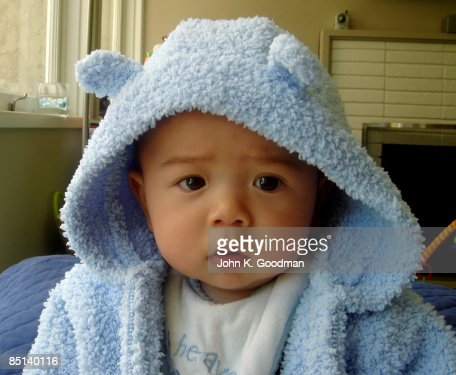 baby boy dressed in blue fuzzy animal hoodie stock photo getty images. Black Bedroom Furniture Sets. Home Design Ideas