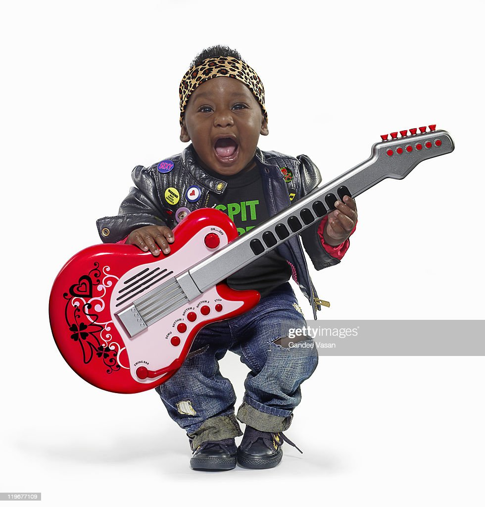 Baby boy dressed up as rock star : Stock Photo
