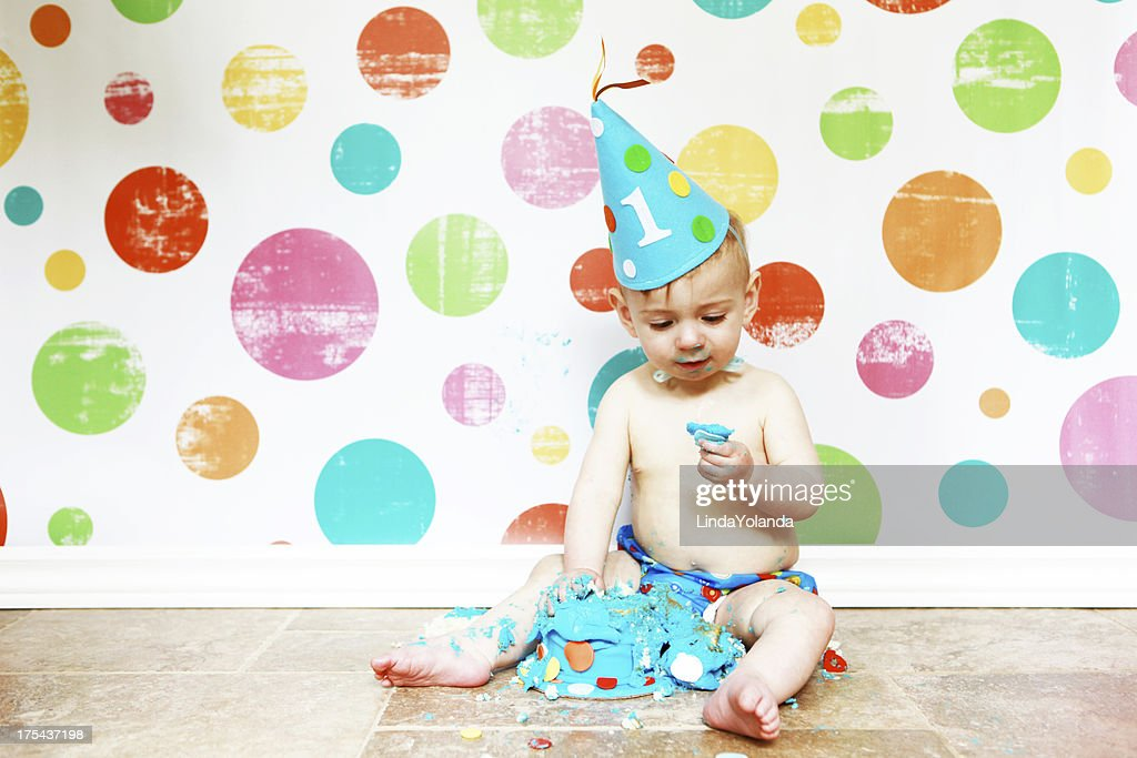 Baby Boy Eating First Birthday Cake