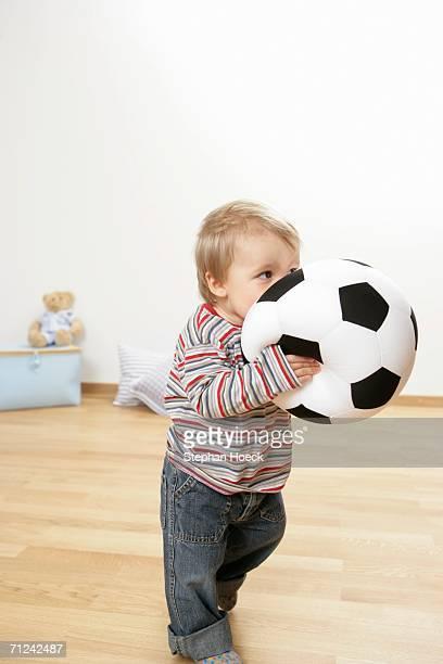 Baby boy holding a football
