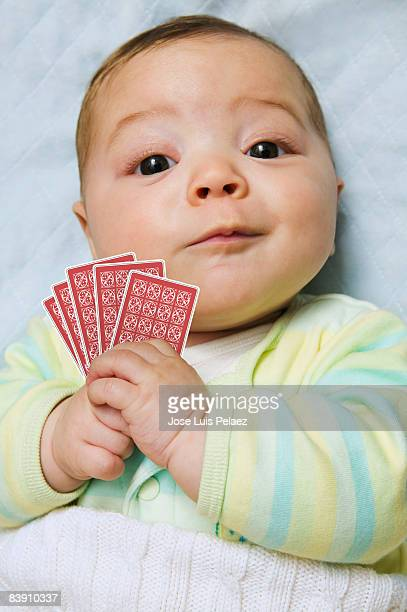 Baby boy holding cards