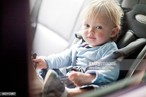 Baby boy in back seat of car