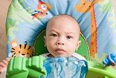 Baby boy in bouncy seat