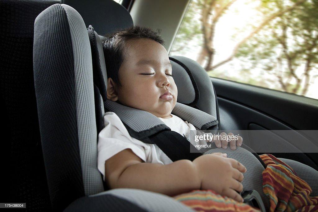 Baby boy in car seat : Stock Photo