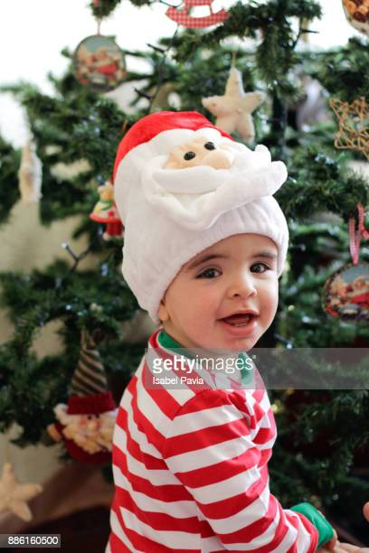 Baby boy in front of Christmas tree