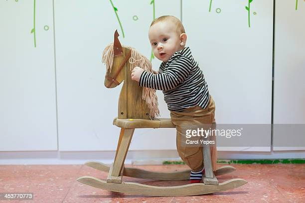Baby boy in her wooden horse