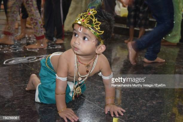 Baby Boy In Krishna Costume While Crawling On Floor
