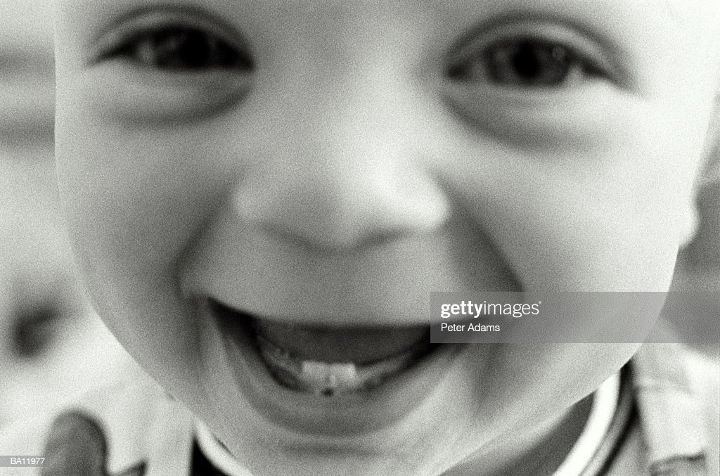 Baby boy (18-24 months) laughing, close-up (B&W) : Stock Photo