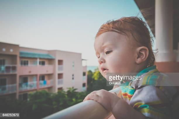 Baby Boy on Balcony at Tourist Resort