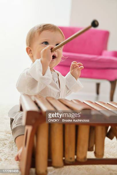 Baby boy playing a xylophone