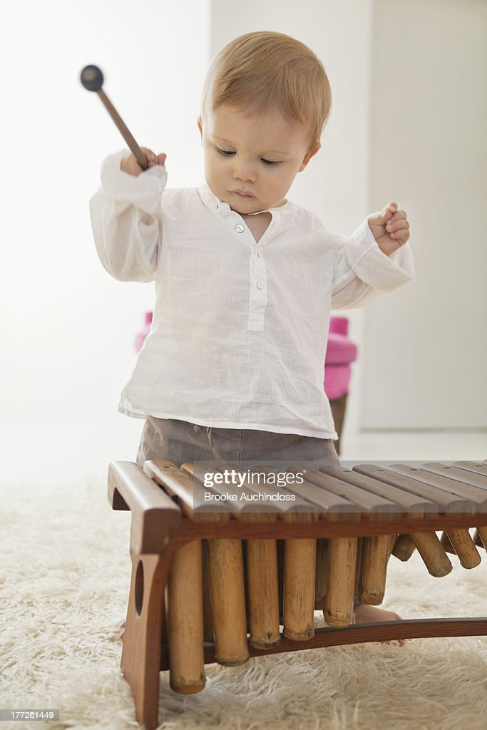 Baby boy playing a xylophone : Stock Photo