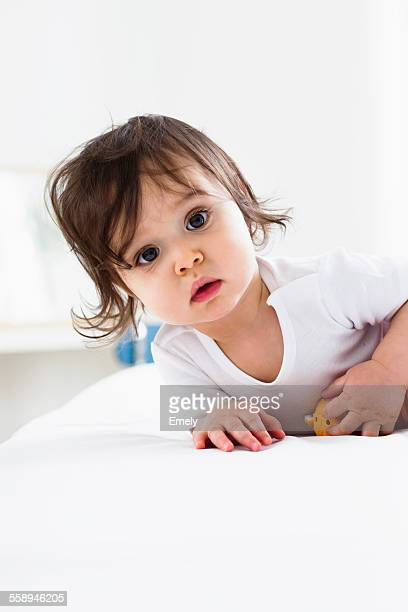 Baby boy playing on floor