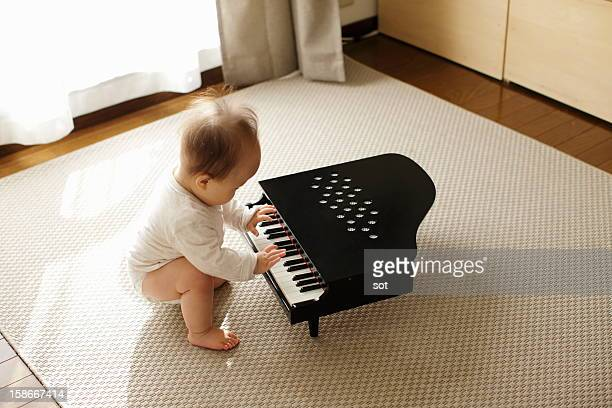 Baby boy playing small piano