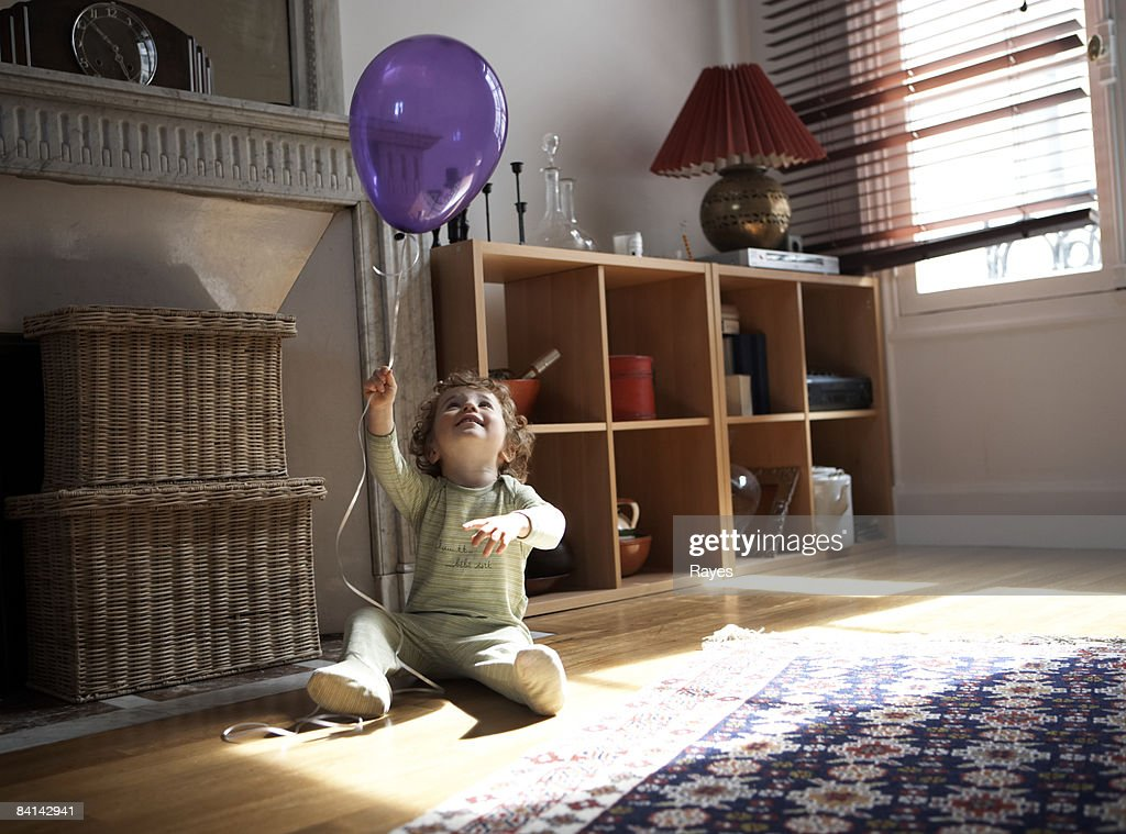 baby boy playing with balloon : Stock Photo