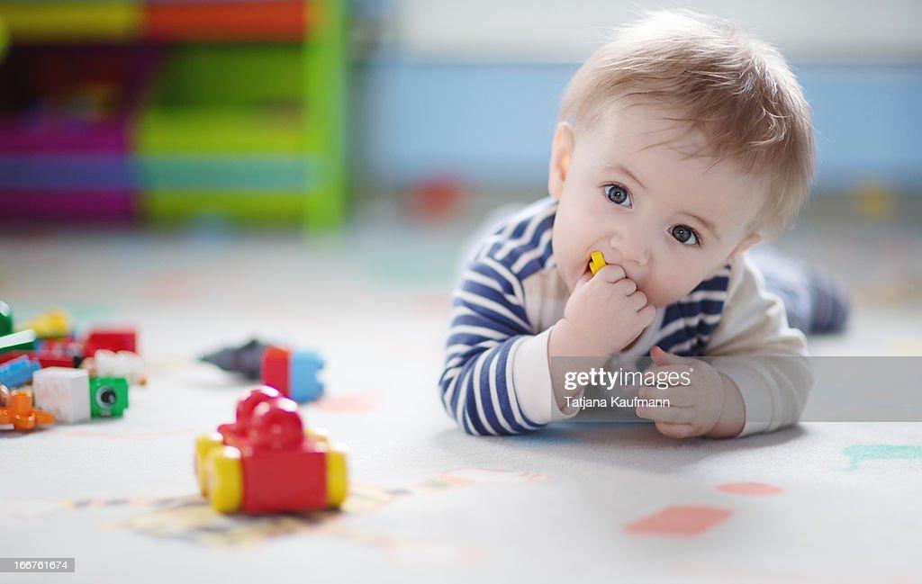 Baby Boy playing with Bricks : Stock Photo
