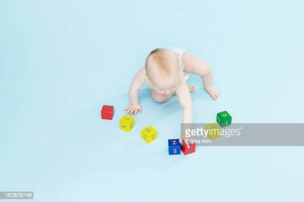 Baby boy playing with colored blocks