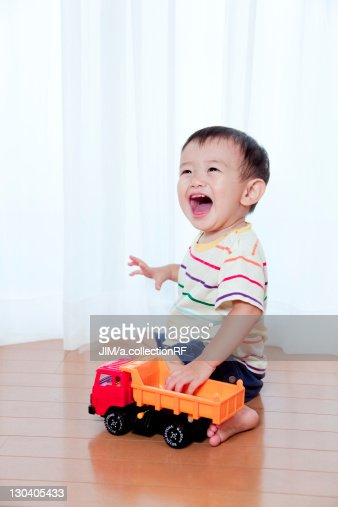 Baby Boy Toy Cars : Baby boy playing with toy car stock photo getty images