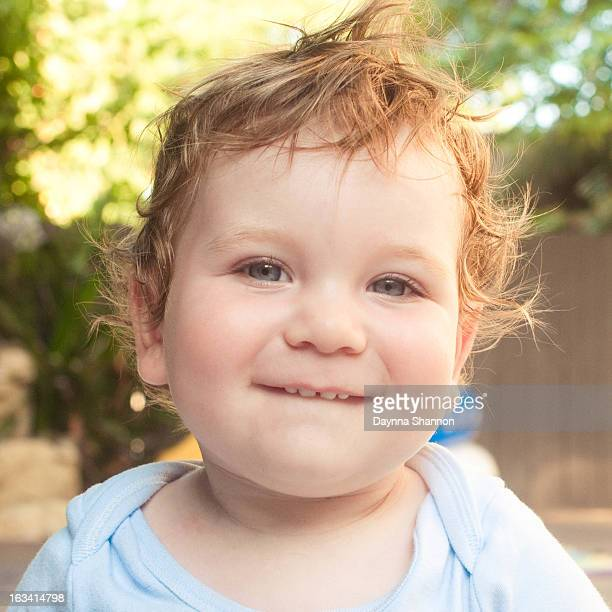 baby boy portrait, outside with messy curls