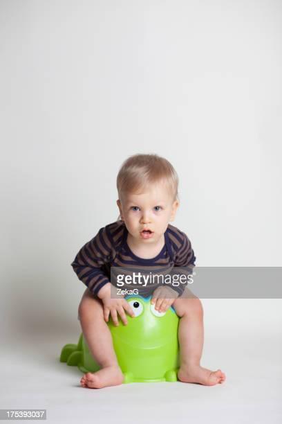 Baby boy potting training