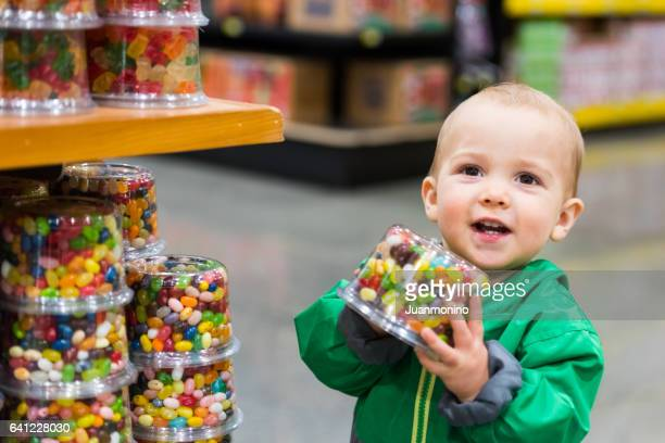 Baby Boy shopping for candies
