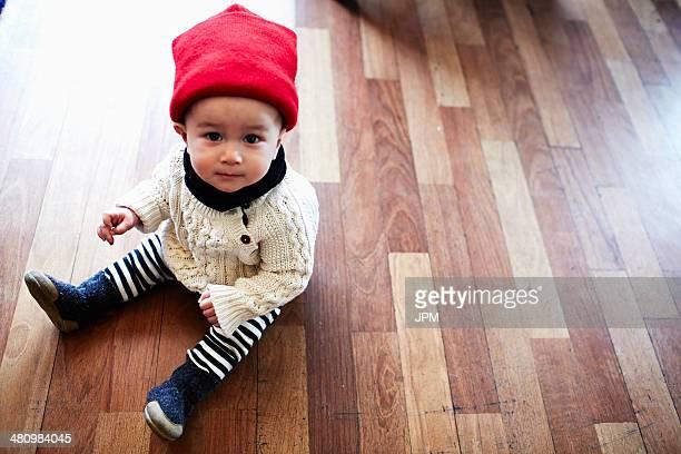 Baby boy sitting on floor