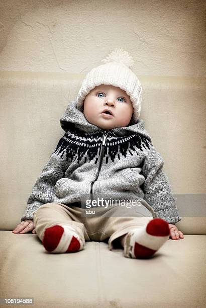 Baby Boy Sitting Up with Warm Hat On