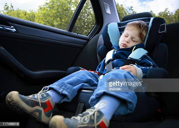 Baby boy sleeping in car seat