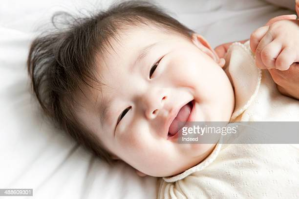 Baby boy smiling on bed