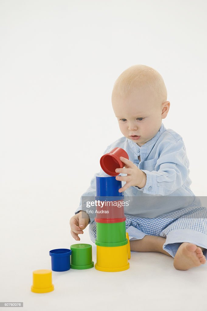baby boy stacking blocks stock photo getty images