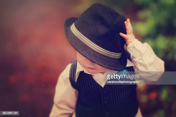 Baby boy tipping fedora hat