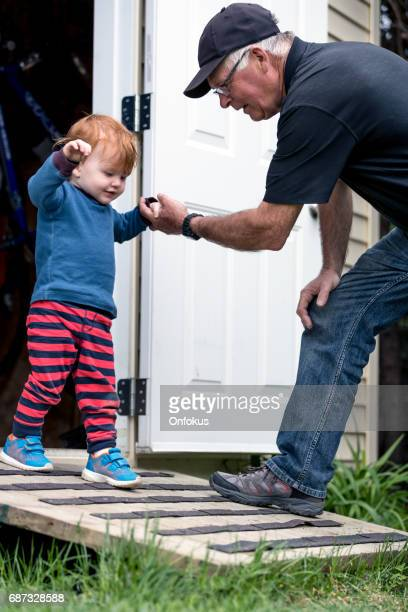 Baby Boy Walking, Moving Down with Grandfather on Ramp