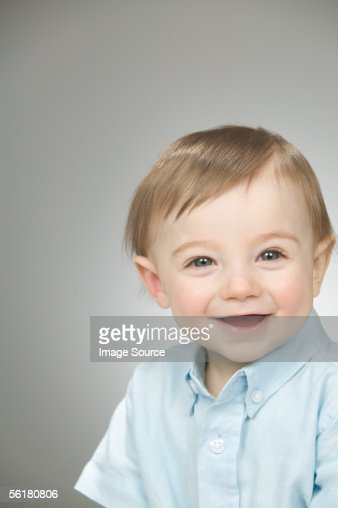 Baby Boy Wearing A Blue Shirt Stock Photo Getty Images