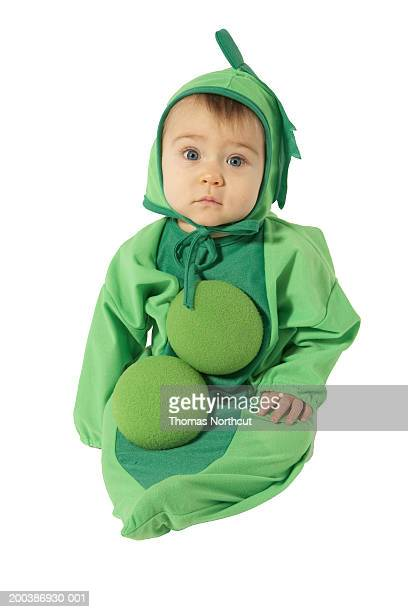Baby boy (9-12 months) wearing pea costume, portrait