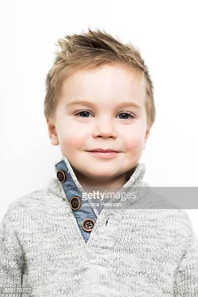 Baby boy (2-3) wearing sweater
