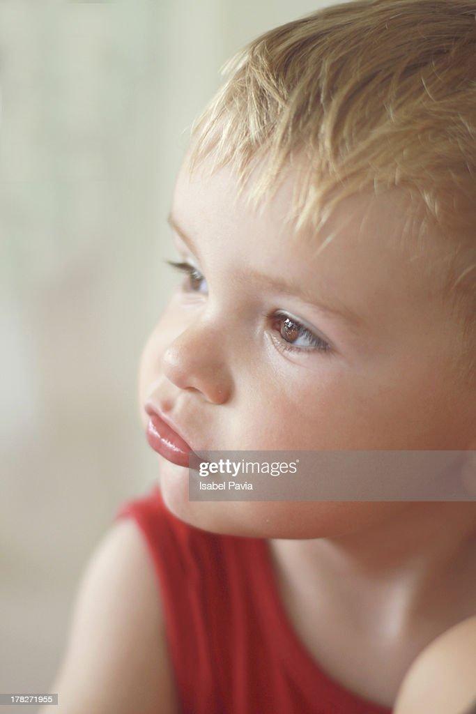 Baby boy whistling : Stock Photo