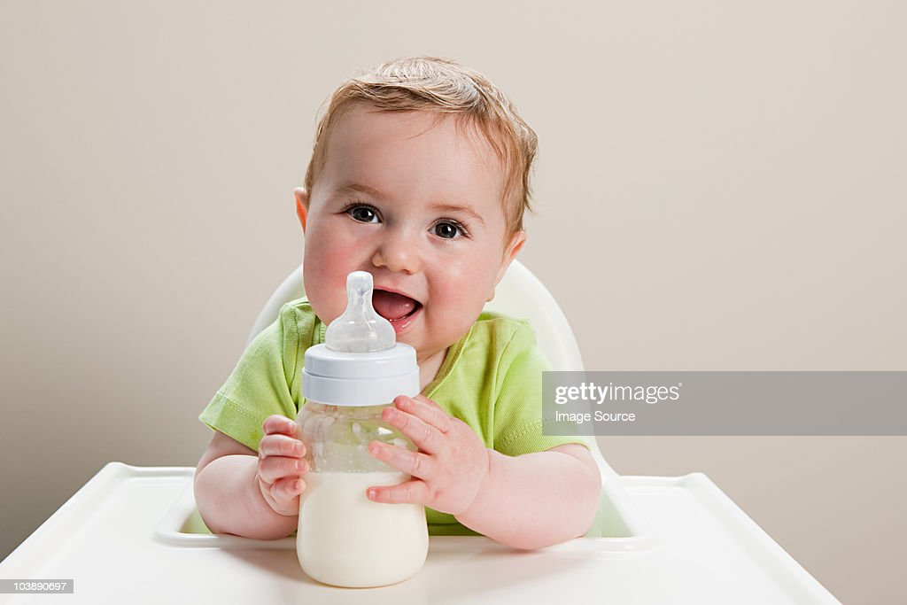 Baby boy with bottle of milk