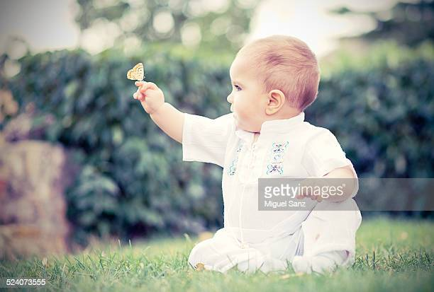 Baby boy with butterfly on the hand