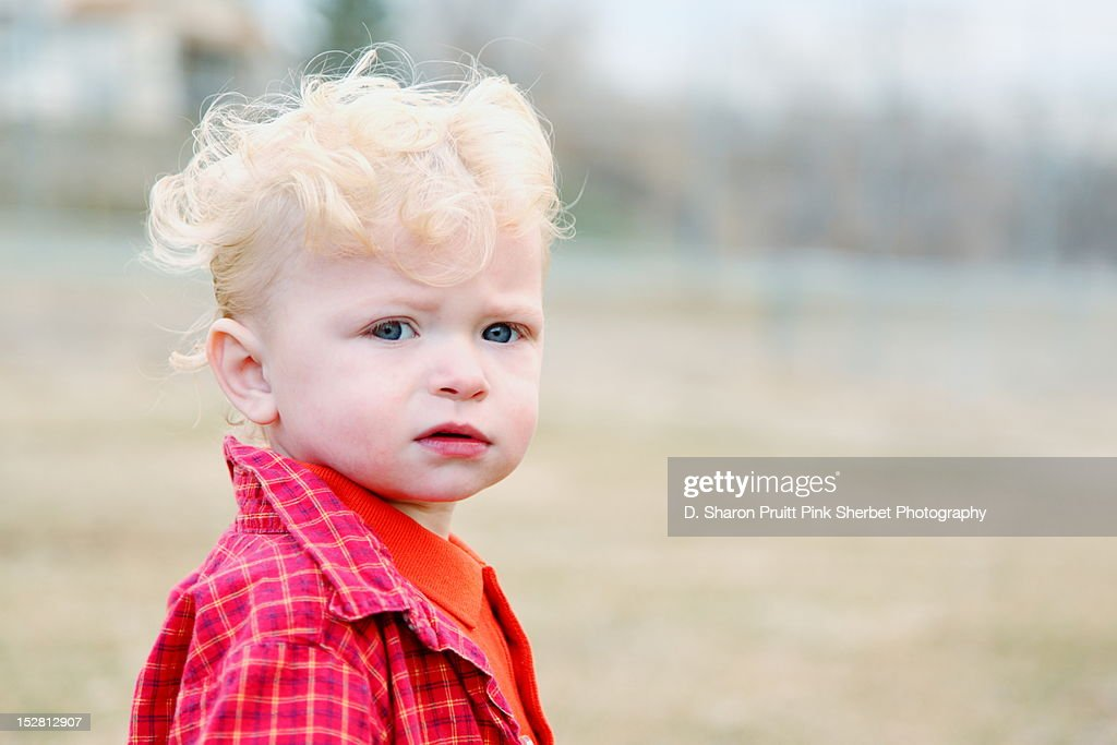 Baby boy with curly hair : Stock Photo