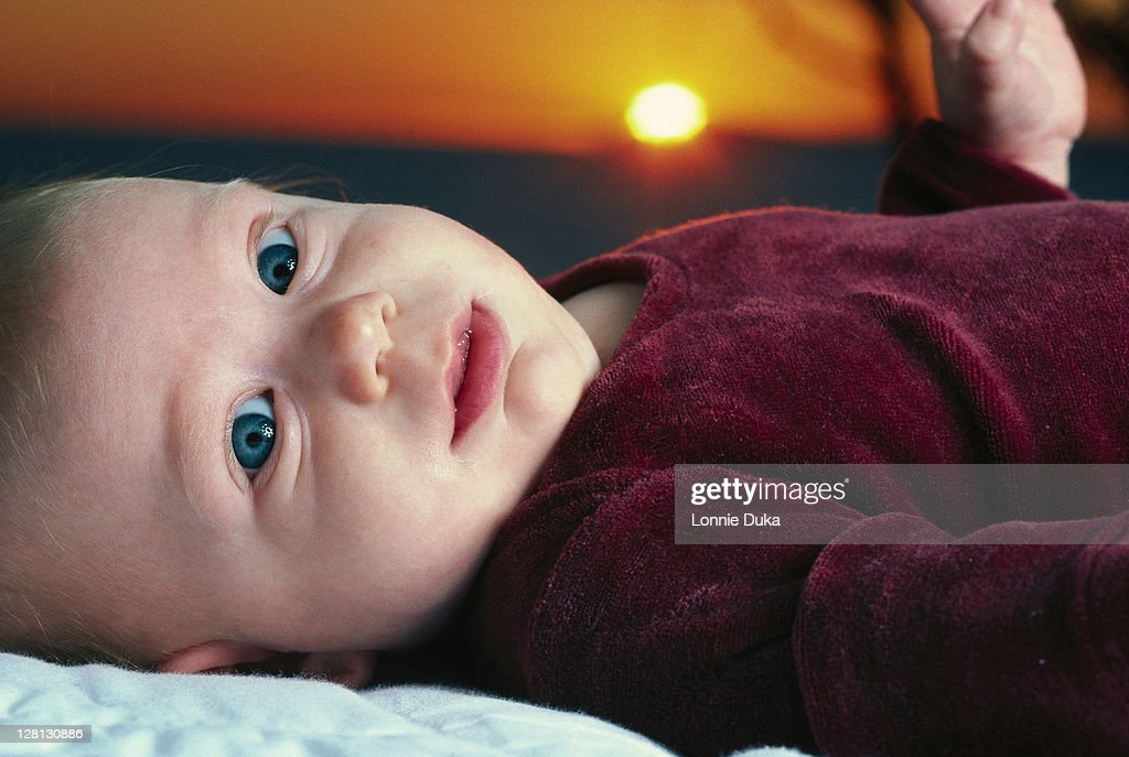 Baby boy with sunset : Stock Photo