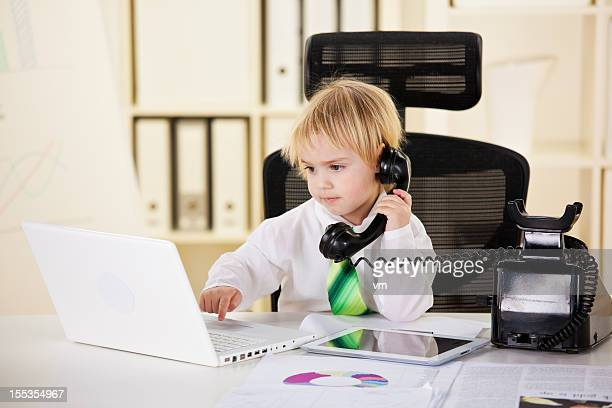 Baby Businessman Working on Laptop