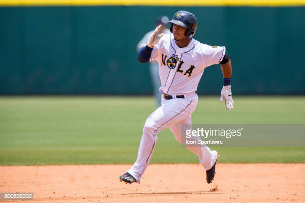 Baby Cakes right fielder Moises Sierra gets a triple of an error by Sky Sox center fielder Kirk Nieuwenhuis during the minor league game between the...
