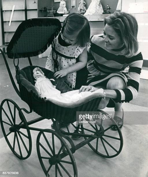 DEC 4 1968 DEC 6 1968 baby carriage on display Also shown in the 'Under the Christmas Tree' exhibit are antique creches and story books plus...