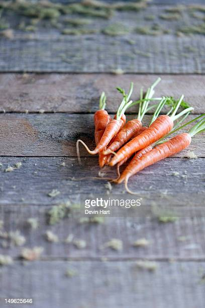 Baby carrots on rustic table
