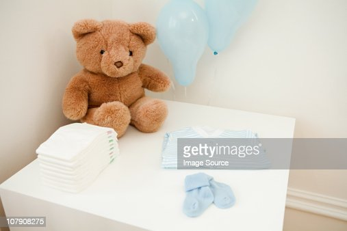 Baby clothes and teddy bear