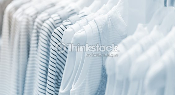 Baby clothes collection hanging in show room : Stock Photo