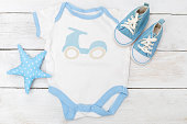 Baby clothes for little boy  on wooden background. Flat lay