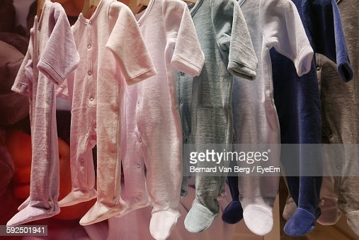 Baby Clothes Hanging At Shop