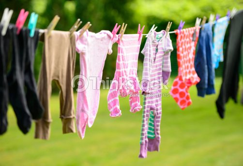 baby clothes hanging on a line stock photo thinkstock