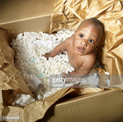 Baby coming out of box : Stock Photo