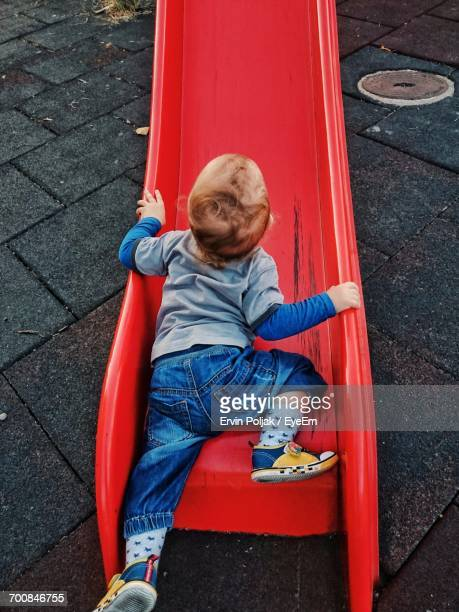 Baby Crawling On Slide